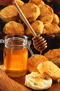 bread beside honey jar