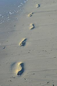 foot steps at seashore