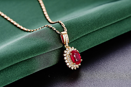round silver-colored red gemstone pendant necklace