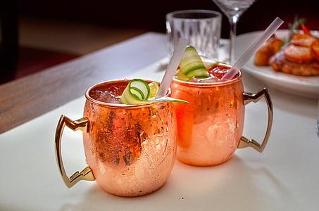 two orange glass mugs