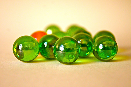 tilt shift lens photography of green marble balls