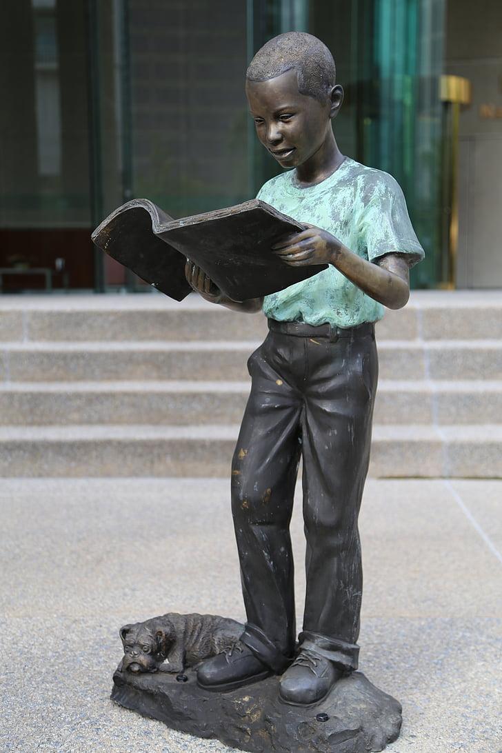 boy reading book statue