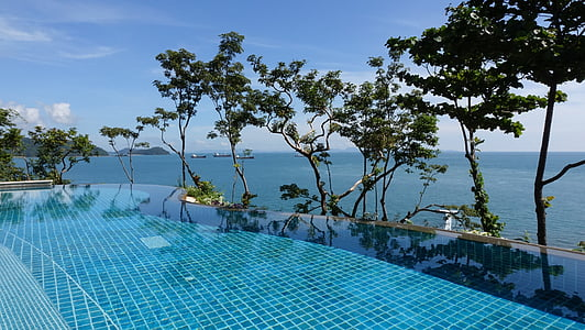 blue infinity pool during daytime