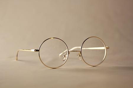 selective focus photo of gold framed hippie eyeglasses