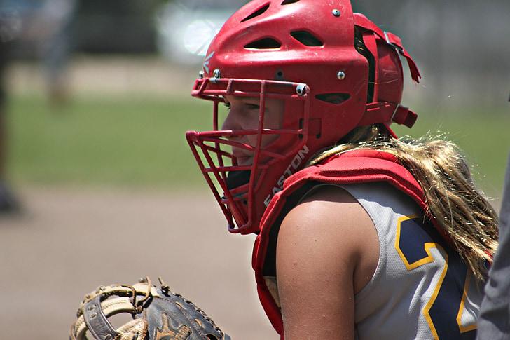 woman wearing red baseball helmet