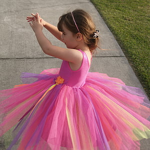 girl wearing pink tutu dress