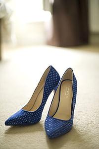 pair of women's blue-and-white stilettos