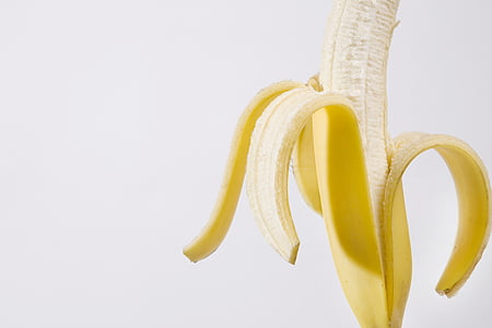 peeled banana with white background