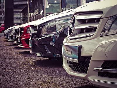 white Mercedes-Benz car park
