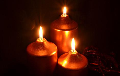 three lighted brown lights