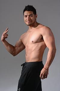 man wearing black bottoms