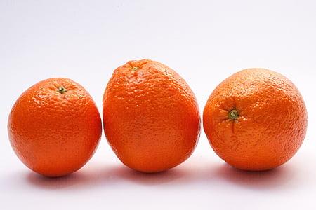 three oranges on white board