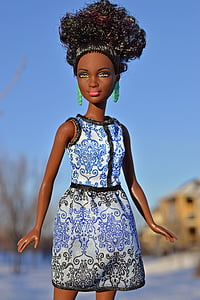 blue and white dressed doll