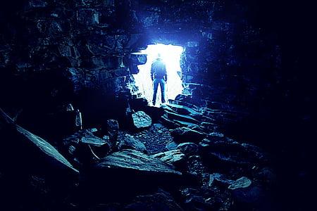 man outside cave