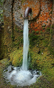 flowing water from brown pipe