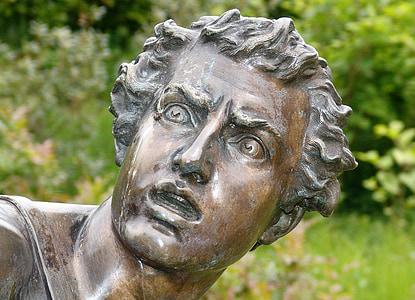 bronze sculpture of man