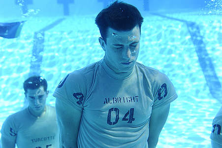 men under pool photo