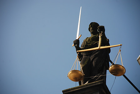 closeup photo of Lady Justice statue