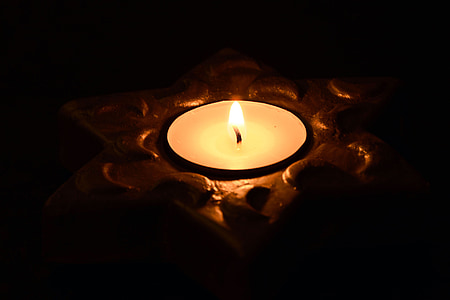 close up photo of lighted tealight candle