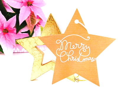 brown and white star table decor with merry Christmas text