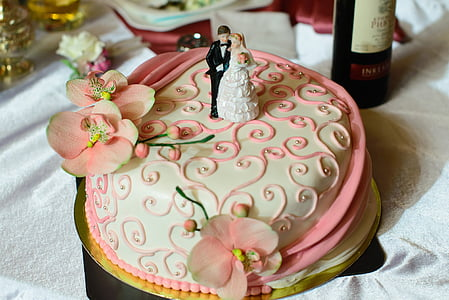 white and pink icing-covered cake