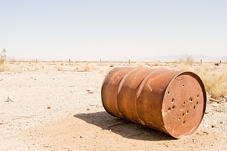 brown barrel on desert during daytime