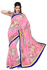 woman standing wearing pink floral sari dress