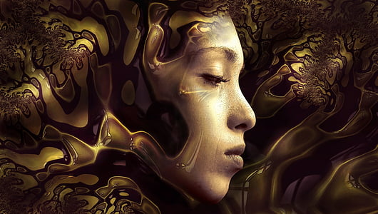 woman's face surrounded by gold liquid