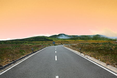 gray concrete road during sunset