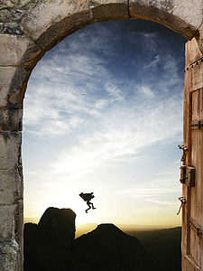 silhouette of person jumping off the cliff during sunrise photo view from dome gray concrete entrance