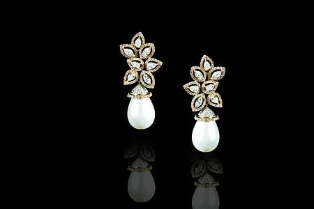 pair of white earrings