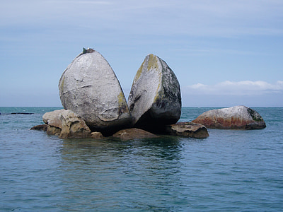 two big rocks surrounded by water