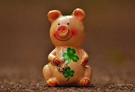 pink and green clover-print ceramic pig figurine macro photography