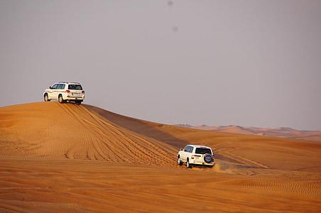 two white SUV on desert