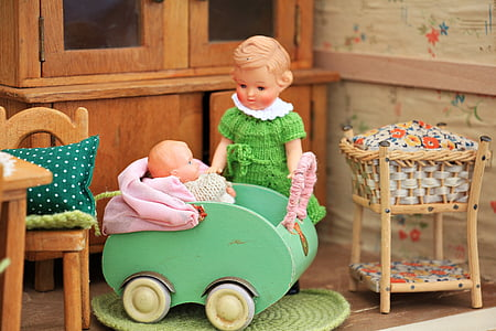 girl and baby doll photograph