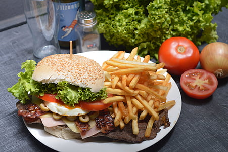 photo of burger with fries on white plate