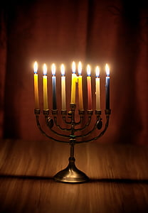 lighted taper candles on candlelabra