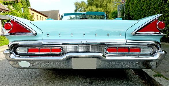 closeup photo of blue muscle car