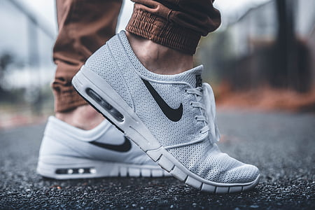 selective focus photography of gray Nike Air Max