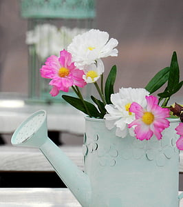 white and pink flowers inside white watering can