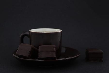 black mug on round black saucer
