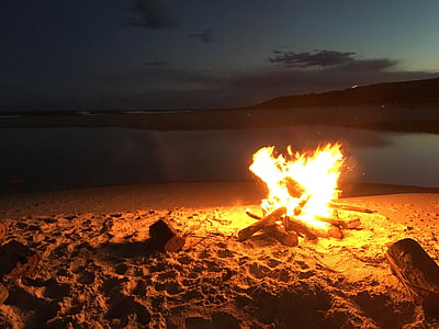 bonfire beside seashore