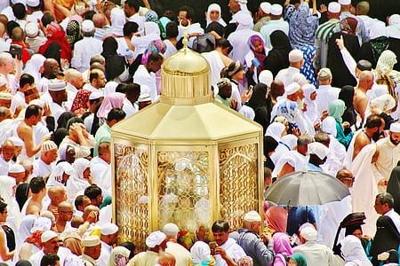 people gathering beside gold altar