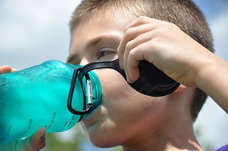 boy holding teal plastic tumbler