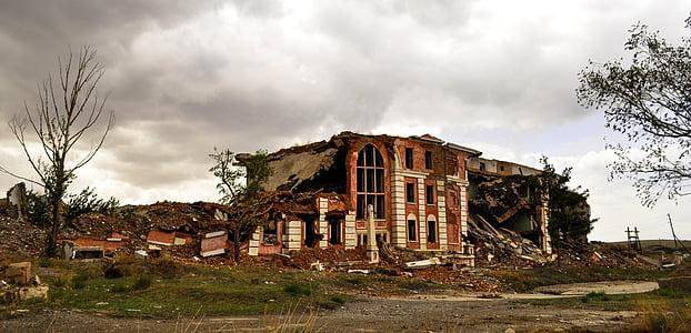 broken house beside trees