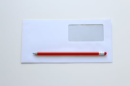 red pencil on white window envelope