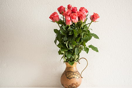 pink rose arrangement on brown vase