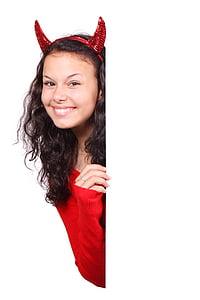 girl wearing devil costume
