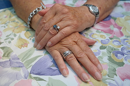 woman wearing three silver-colored rings, link bracelet, and watch