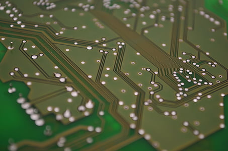 closeup photo of green circuit board